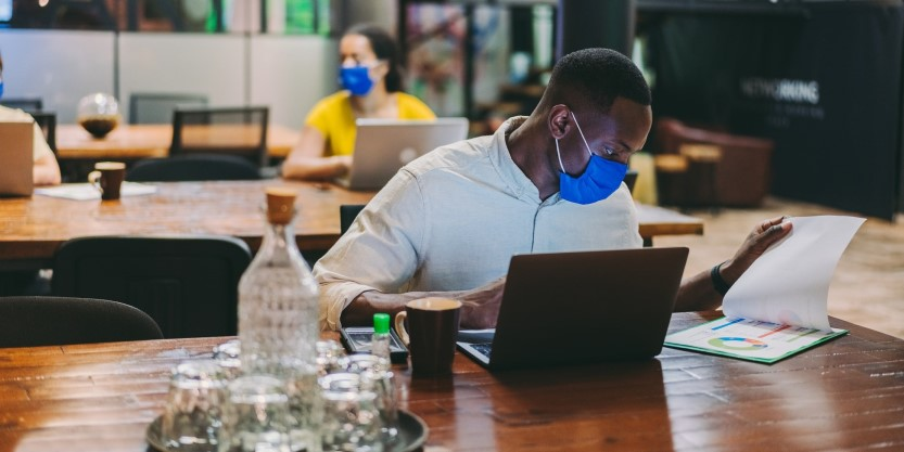people working while wearing mask